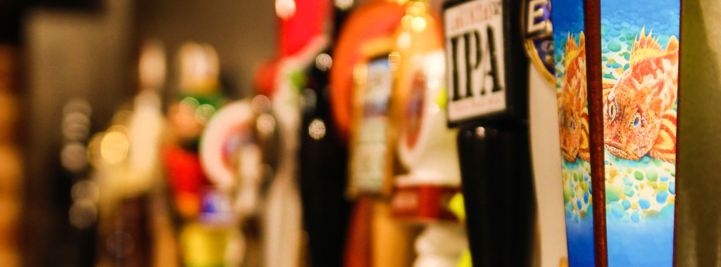 Craft beer taps at Twisted Oak American Bar & Grill